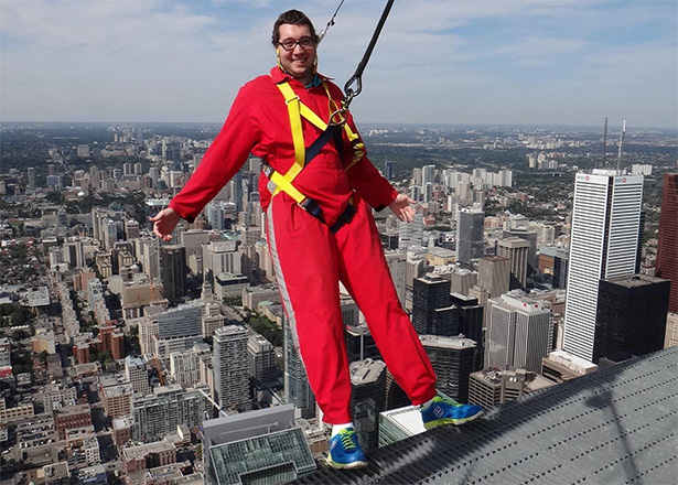 Gordon V walks outside the CN Tower, high above Toronto, after completing cancer treatments in 2012. (Handout)